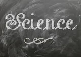 science written on blackboard with chalk