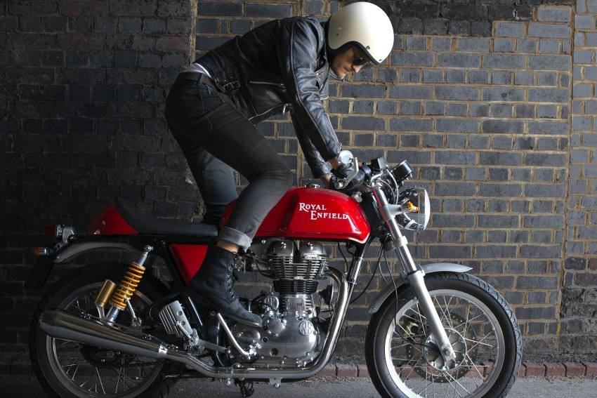 Rider kick starts motorcycle.