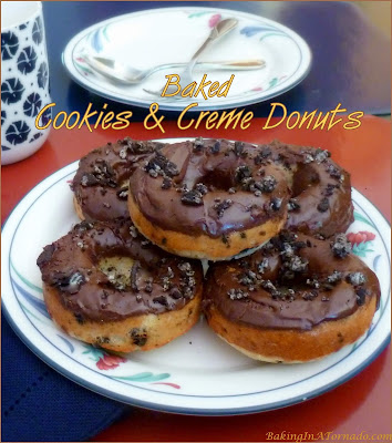 Baked Cookies and Crème Donuts are light and fluffy donuts studded with chunks of cookies and topped with a sweet chocolate glaze. | Recipe developed by www.BakingInATornado.com | #recipe #chocolate