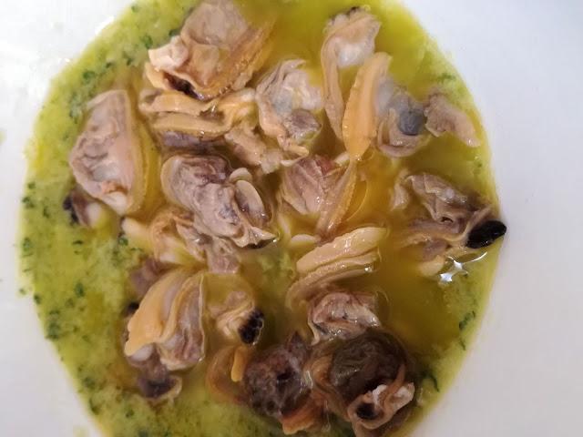 Condimento brodo di vongole, prezzemolo ed aglio
