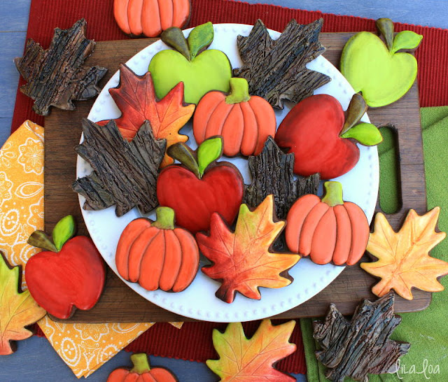 Beautiful fall chocolate decorated sugar cookies -- apples, pumpkins, leaves, bark texture