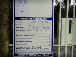 Panneau de permis de construire.