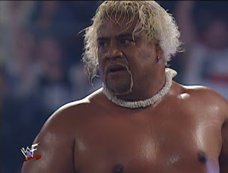 WWE / WWF - Fully Loaded 2000 -  Rikishi gets ready to jump off the top of the cage onto Val Venis