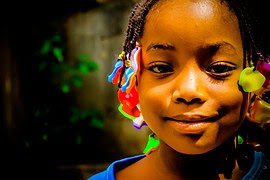 african child wearing beads