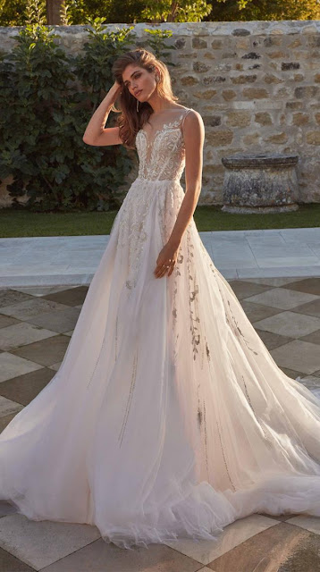 Elaborate embroidery trail down this ice silver and pink A-line ball gown - weddings ideas - wedding planning services in Philadelphia PA - weddings ideas blog by K'Mich Weddings