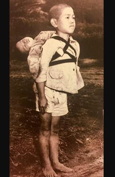 'The fruit of war': Pope Francis prints photo of Nagasaki victims
