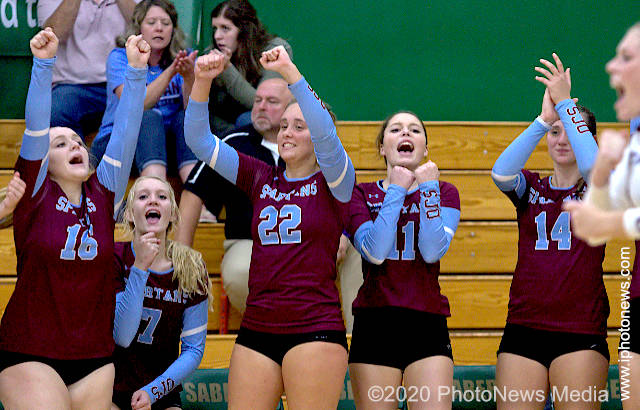 St. Joseph-Ogden volleyball players celebrate a point against STM