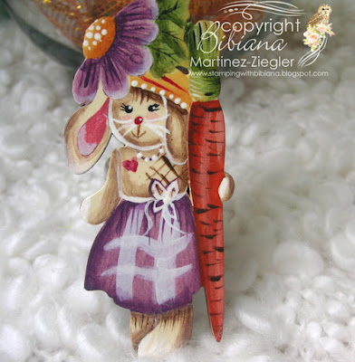 easter bunny pin holding a carrot