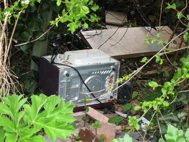 Washing machine (or tumble drier?) in a ditch.