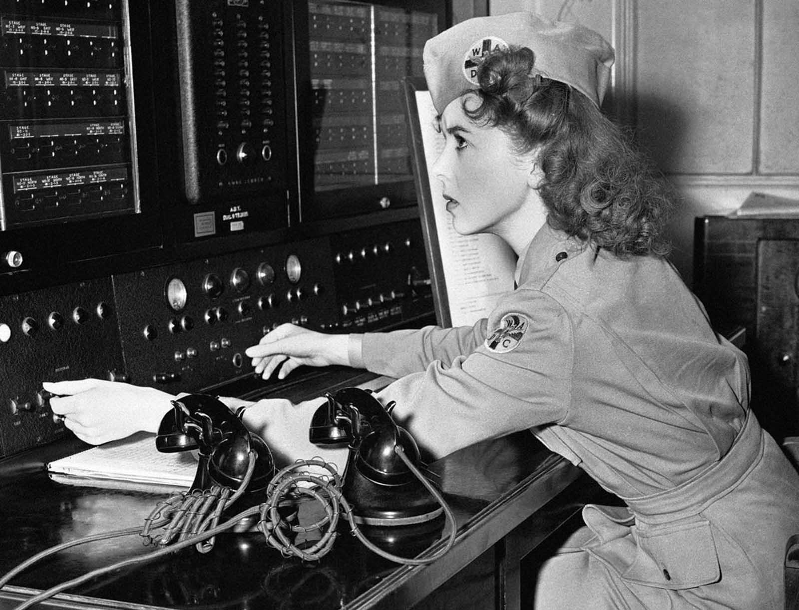 Movie actress Ida Lupino, is a lieutenant in the Women's Ambulance and Defense Corps and is shown at a telephone switch board in Brentwood, California, on January 3, 1942. In an emergency she can reach every ambulance post in the city. It is in her house and from here she can see the whole Los Angeles area.