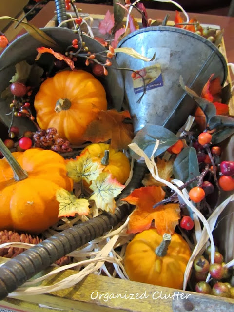 Funnels Re-Purposed as Fall Cornucopias http://organizedclutterqueen.blogspot.com/2013/10/funnels-re-purposed-as-fall-cornucopias.html