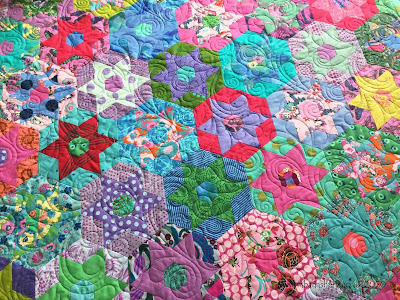 English Paper Pieced quilt made by Mercedes.   Quilted by Fabadashery Longarm Quilting