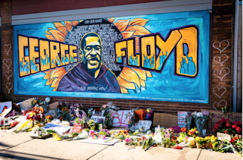 Image of mural with George Floyd's name and face with a sunflower in the background