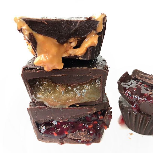 Filling chocolate cups with different fruit fillings