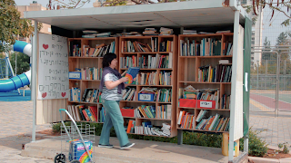 New books are being placed in the street library.