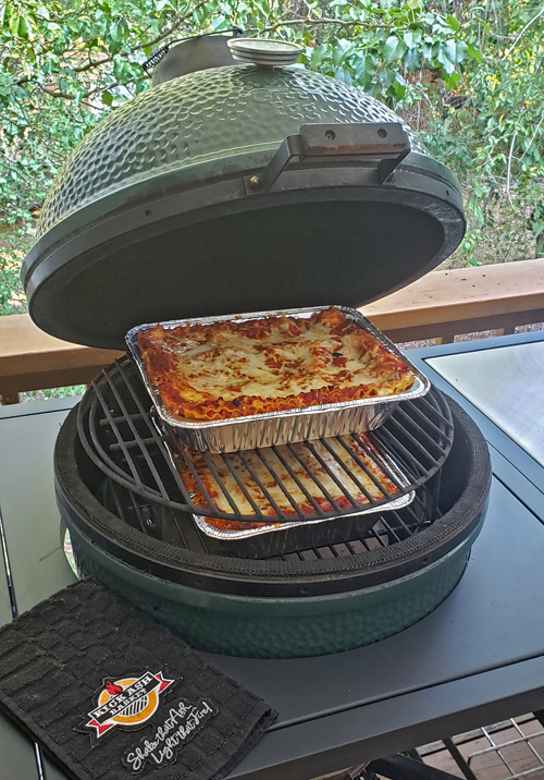 Two pans of lasagna on a Big Green Egg using an Adjustable Rig