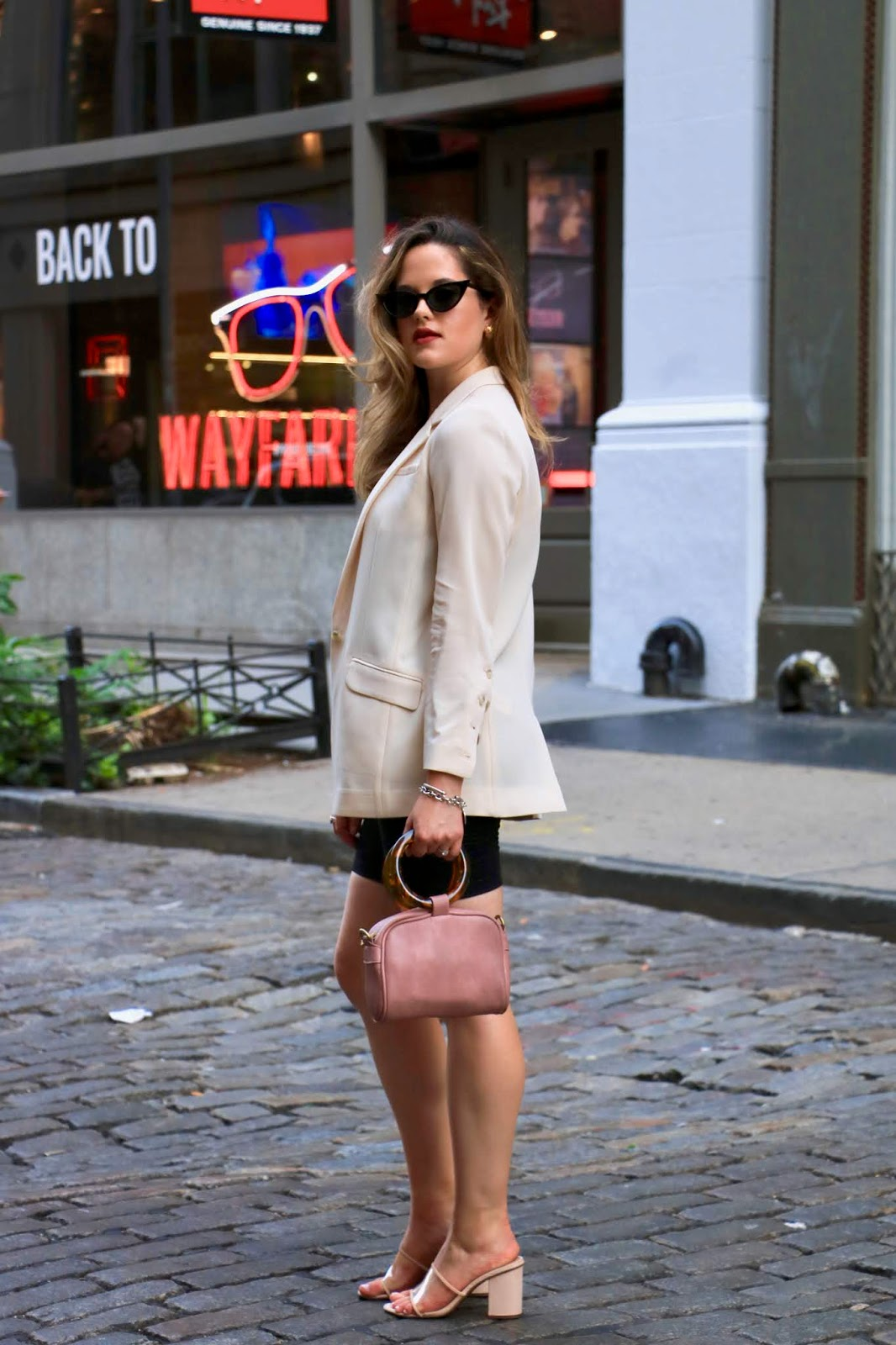 Nyc fashion blogger Kathleen Harper wearing a bike shorts work outfit.