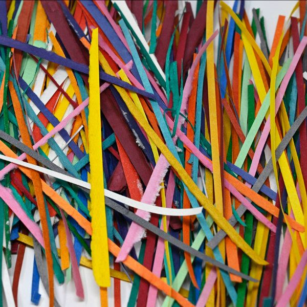brightly colored handmade paper strips with deckle edge