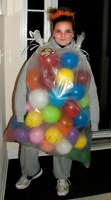 A halloween visitor dressed as a bag of jelly belly jelly beans.