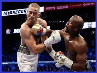 Floyd Mayweather Kalahkan Conor McGregor Lewat TKO