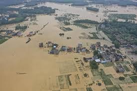 China raises flooding response level to the third-highest