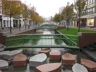 Shopping district along a canal with pedestrian bridges, Gedempte Gracht, Zaandam, The Netherlands