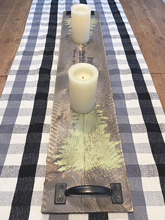 Candles on wooden table runner