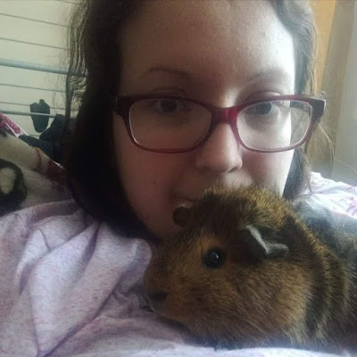 Hayley and guinea pig cuddling