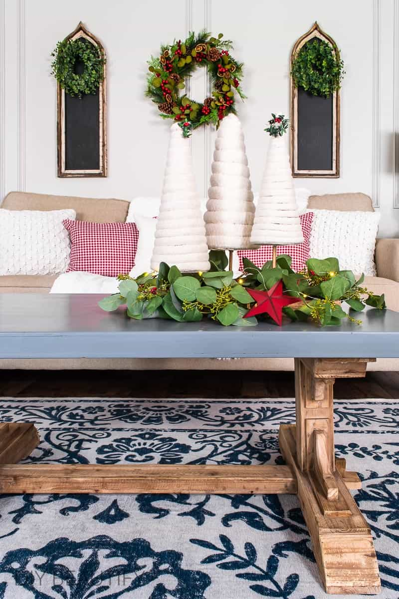 Christmas living room with wreaths and DIY fluffy trees