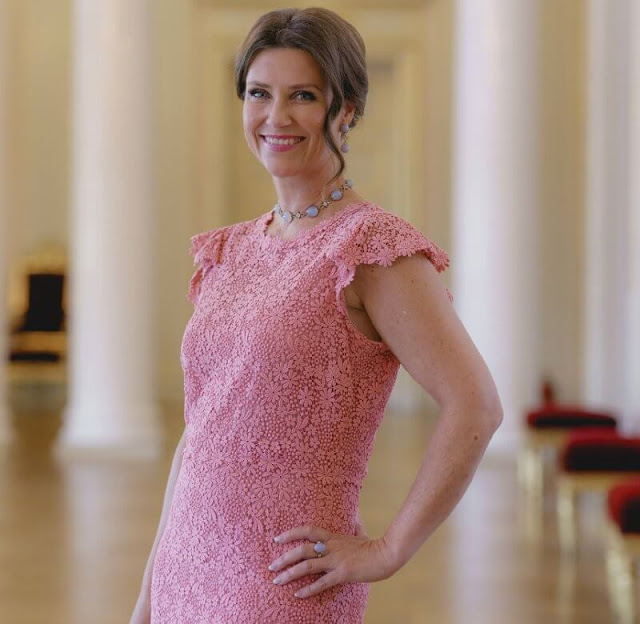 Princess Martha Louise wore a pink lace dress by Valentino. Emilio Pucci blue lace blouse. Crown Princess Mette-Marit wore the same dress