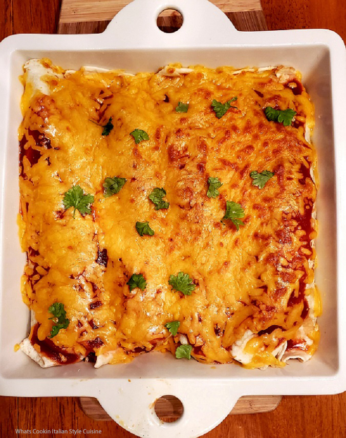 this is a casserole using flour tortilla rolled and filled with beef, rice beans and cheese.