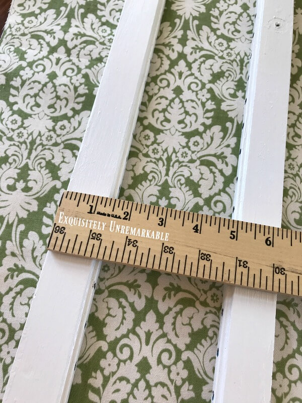 Measuring Fabric For Shutters with a yardstick