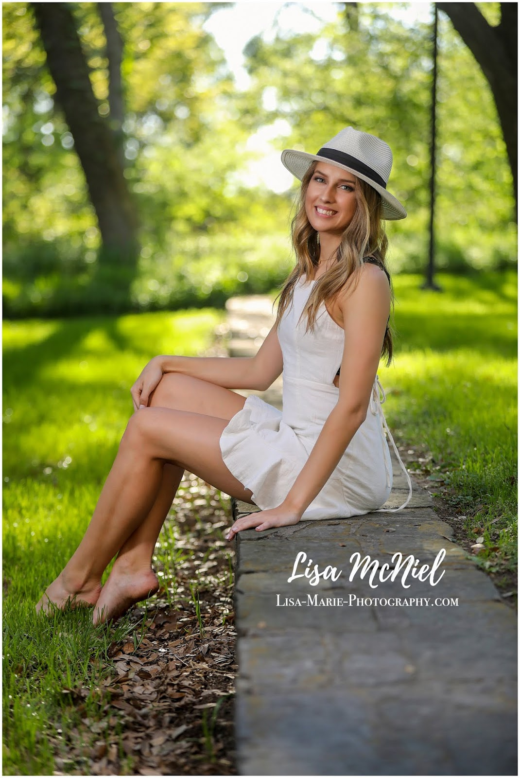 pretty teen girl in white dress and hat
