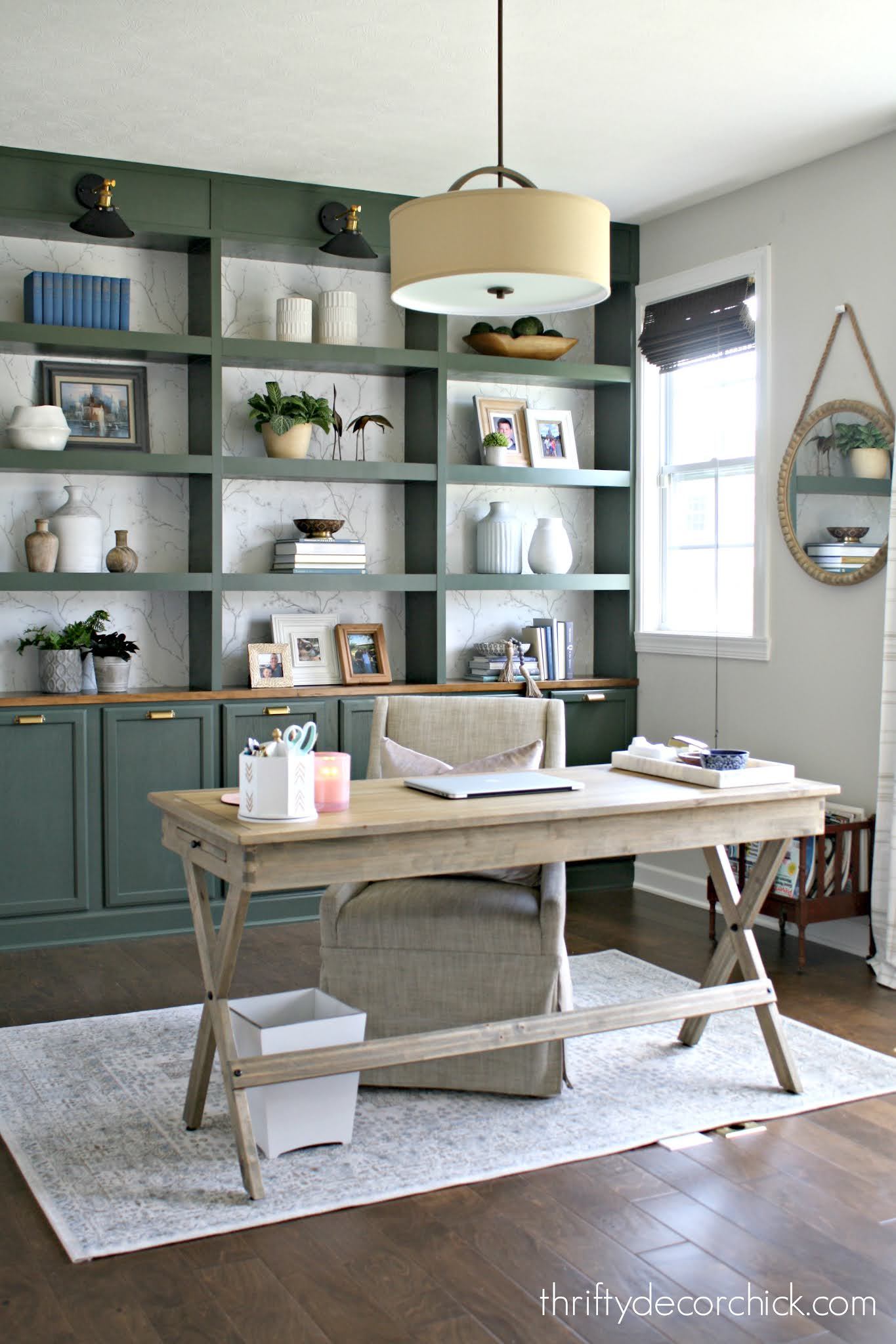 green bookcases with desk