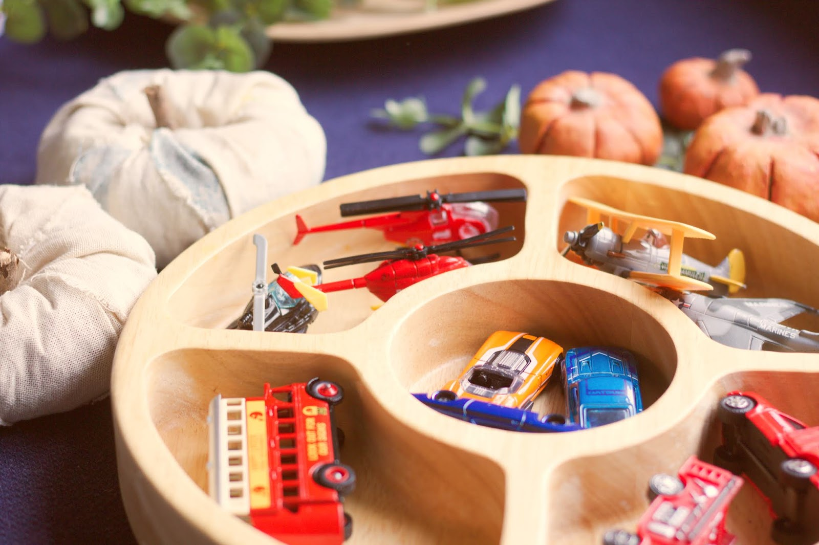 Montessori-inspired hands-on activities with vehicles. How to make the most out of the toys