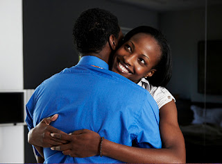 black_woman_embraces_black_man
