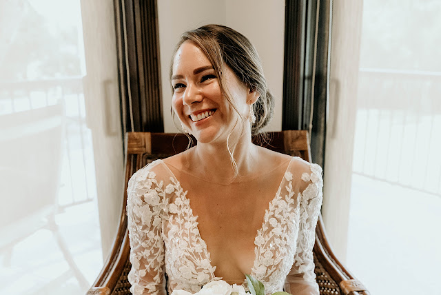 Bride smiling in seat The Manor on St Lucie Crescent Wedding captured by Stuart Wedding Photographer Heather Houghton Photography