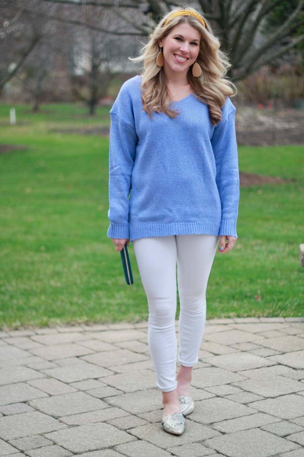 spring outfit with white jeans, blue sweater, snakeskin mules, white jeans, JORD wallet, yellow headband