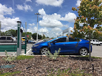 Blue Chevy Volt Charging (Credit: GM) Click to Enlarge.