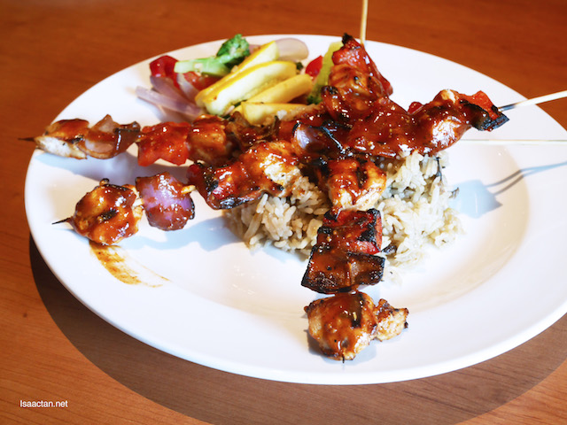 The skewers come on these yummy mushroom rice