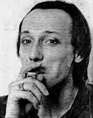 Howard Devoto smoking a cigarette - like that's a good idea!