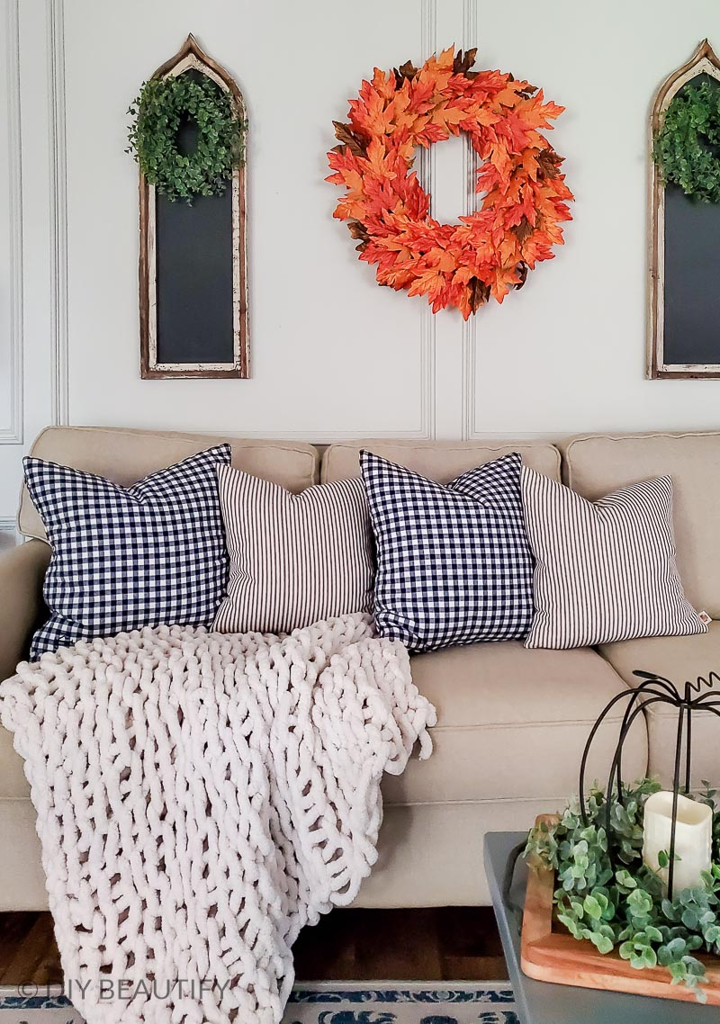 living room with chunky throw and colorful fall wreath
