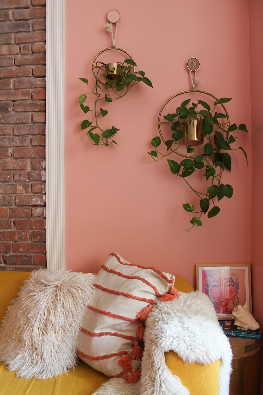 clare paint rose season, pink blush living room, coral living room, pink bohemian living room inspo, pink wall Inspo, pink wall inspiration, maximalist pink living room, pink room ideas, coral room ideas, pink room wall, how to paint your walls pink, best pink paint for walls, best vac-free paint, Clare paint rose season, Clare paint living room, Clare paint review, Pink Walls and Exposed Brick, Warm Pink Living Room, Small Space Apartment Inspo, Astoria Queens Apartments, Small Space NYC Apartment inspo