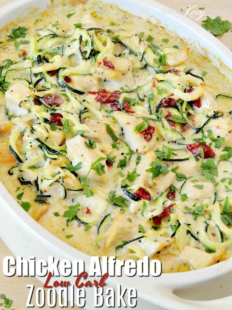 This keto-friendly, low carb Chicken Alfredo Zoodle Bake recipe is so creamy and delicious you will never miss the pasta and it will easily become a family favorite! #lowcarb #keto #chicken #zucchini #zoodle #casserole #easy #recipe | bobbiskozykitchen.com