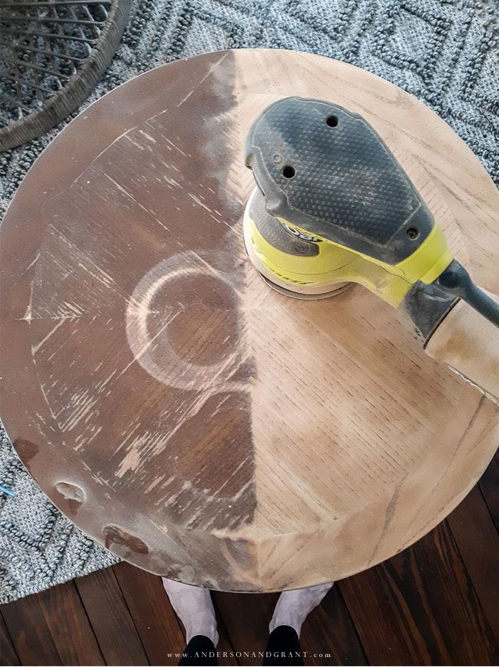 Ryobi orbital sander on end table.