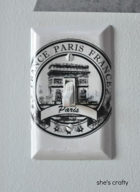 Use vinyl decals to decorate light switch cover in Paris themed teen girl bedroom