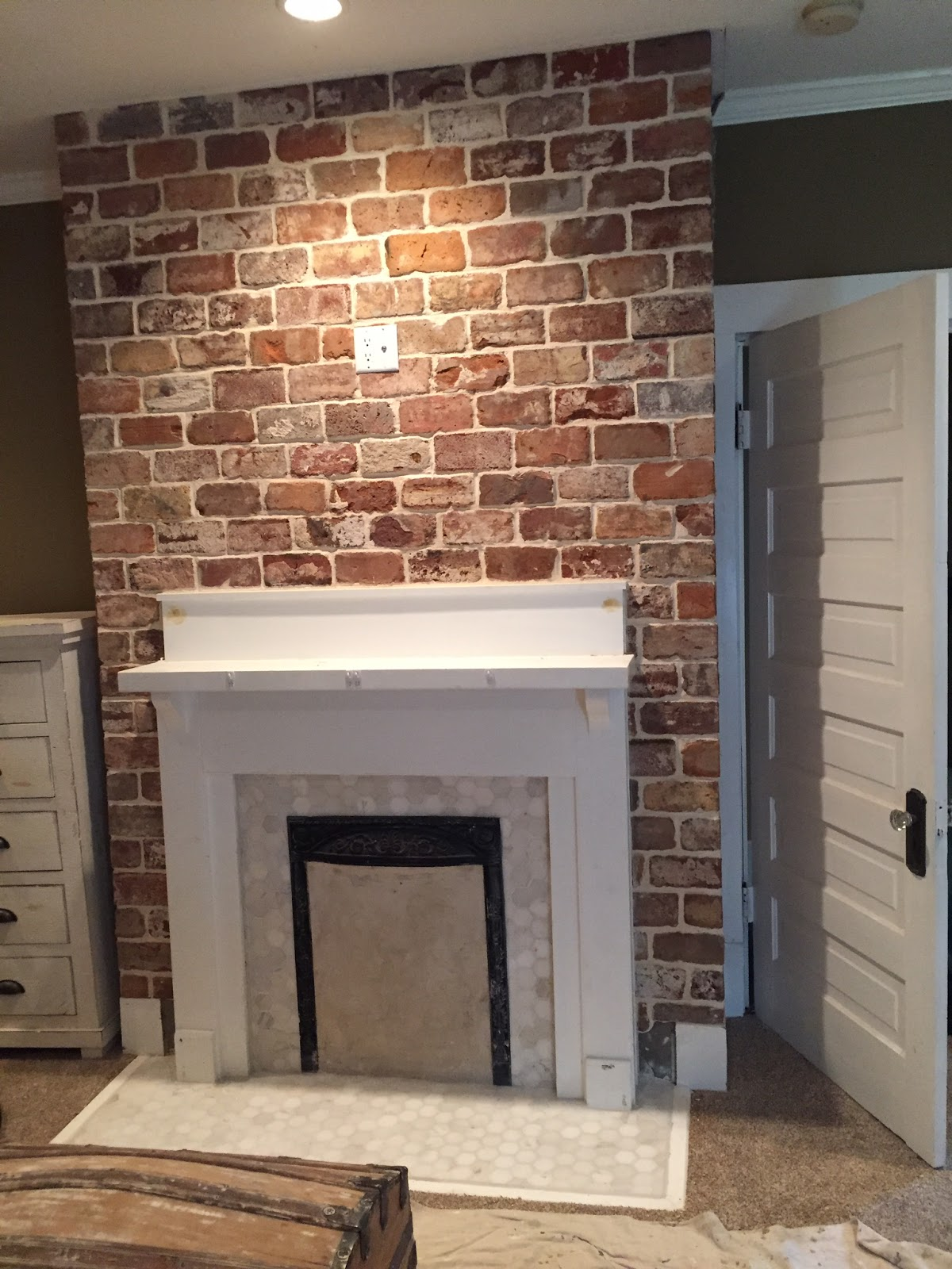 A vintage bricks fireplace installation reclaimed brick - Tile over brick fireplace ...