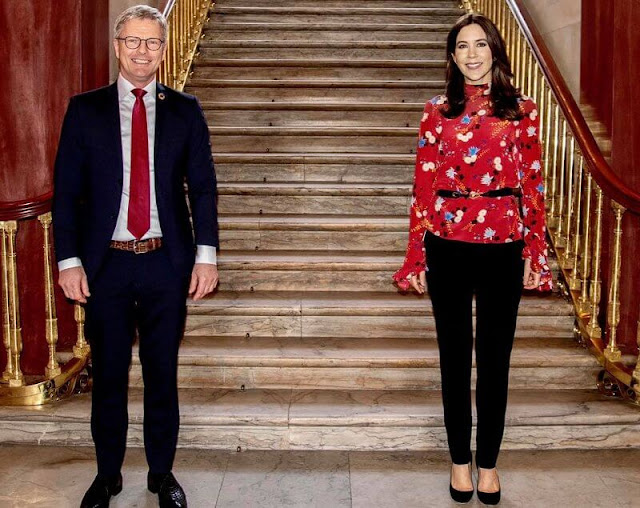 Crown Princess Mary wore a lindsey floral print mock-neck ruffle sleeve blouse from Erdem, and billie black pumps from Jimmy Choo