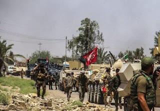 قوات الحشد الشعبي تصنع جسر بديل للجسر الذي دمرة الدواعش في تل ميدان جنوب الحويجة في كركوك