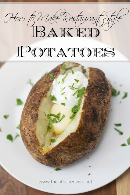 The finished restaurant baked potato, on a white plate, topped with butter, sour cream, and chopped parsley, with the title above.